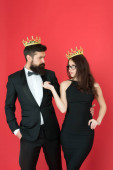 Rich man and woman. Pride and recognition. Prom party. Luxury lifestyle. We are family. Royal bond. Famous person. Attractive queen and big boss enjoy luxury. Business couple wear luxury crowns