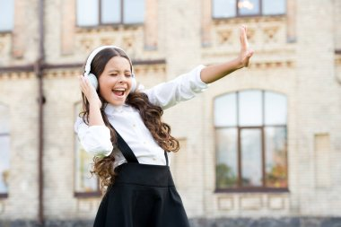pupil listen music. back to school. happy beauty singing outdoor. kid innovating education through audio book. happy childrens day. modern look of schoolgirl. retro kid in uniform and headset
