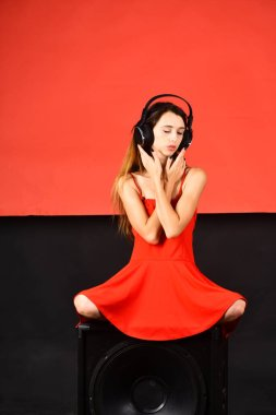 Music and party concept. Girl with loose hair wears headphones.
