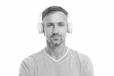 Guy in cap listen music stereo headphones. Good mood. Modern wireless headphones. Perfect sound concept. Electronic dance music and house tracks. Instrumental music. Man headphones white background