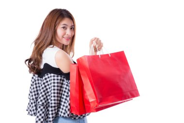 happy excited woman standing and holding colorful shopping bags