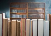 Twelve different books on the background of the library