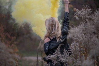Girl - blonde  smoke bomb rear view