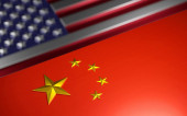 Photo Chinese flag in front of an American flag. Shiny, metallic effect 3D render.