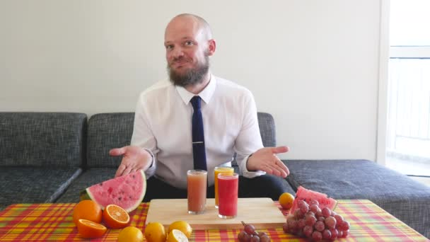 Set of expressions of Business man with grapefruit, orange watermelon and lemon juices. In suburban appartement. Caribbean style table: Healthy lifestyle for summer, many vitamins and lot of happiness