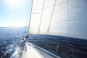 View forward from a sailboat, tilted by the wind