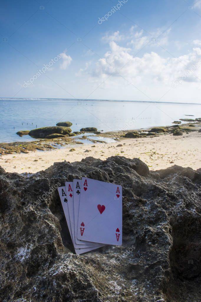 four of a kind ace poker card gamble beach theme