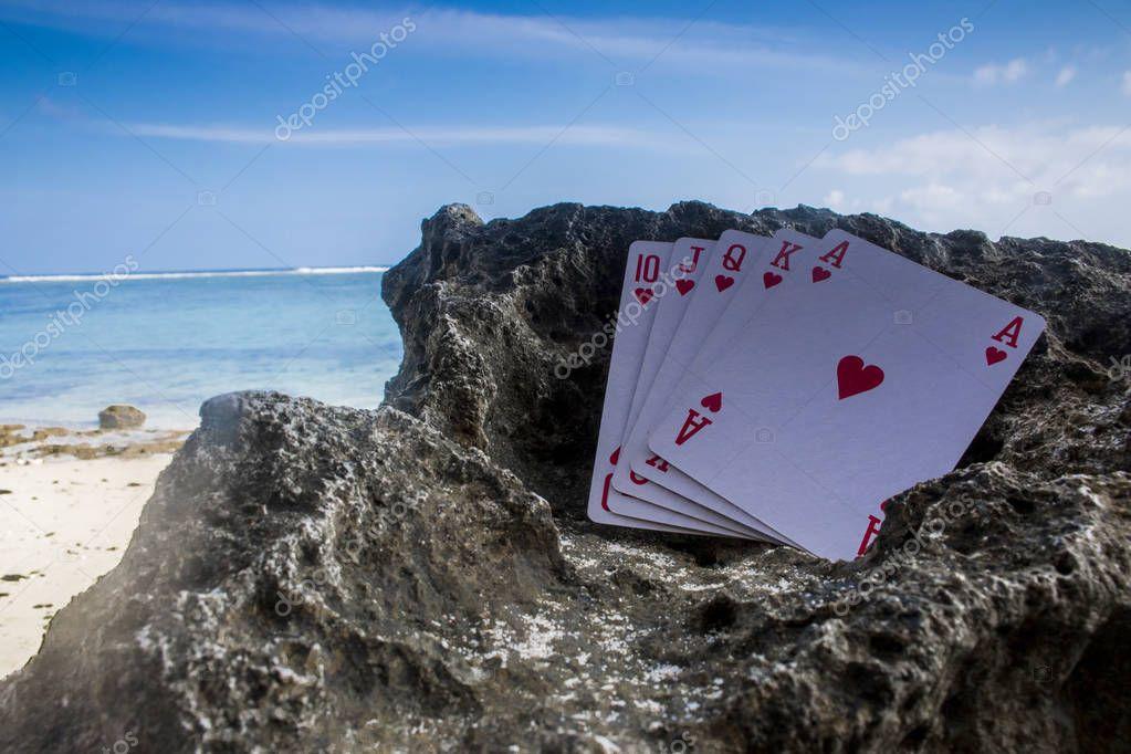 heart royal flush poker card gamble beach theme