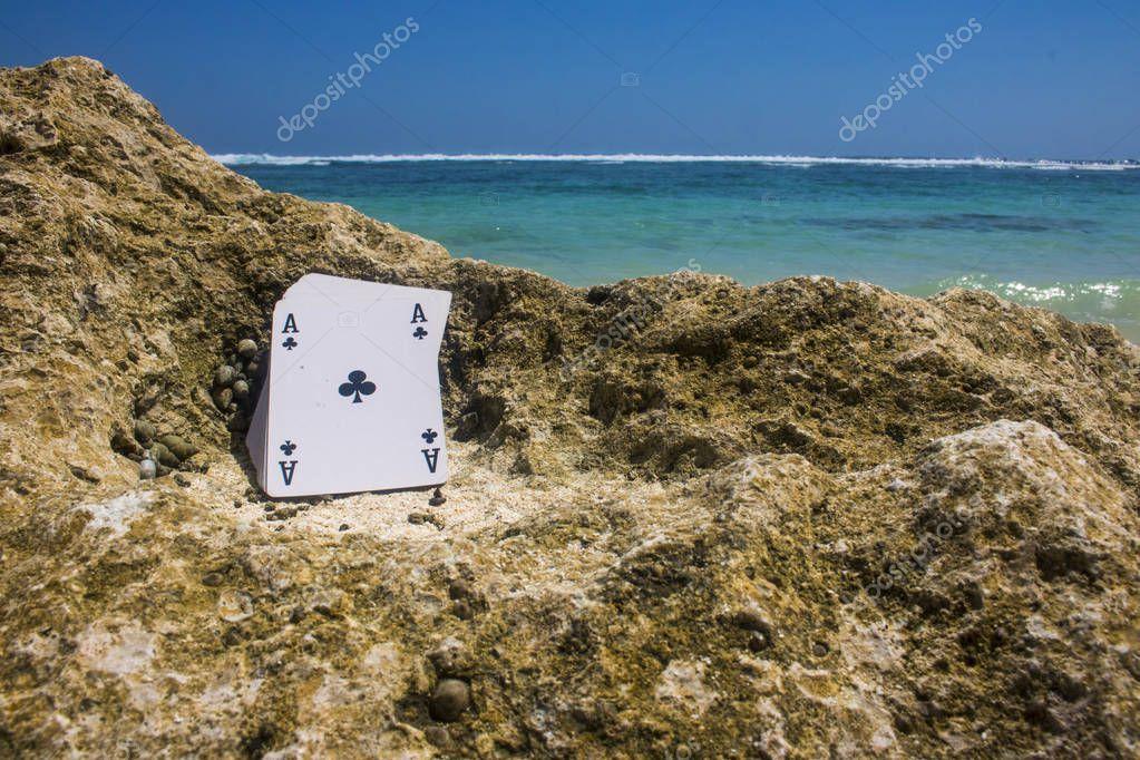 ace of club poker card beach theme photo