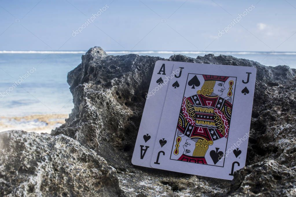 black jack poker card gamble beach theme photo