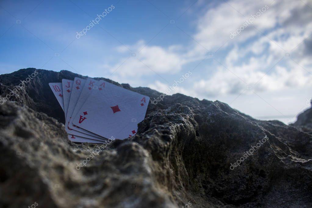 diamond royal flush poker card gamble beach theme