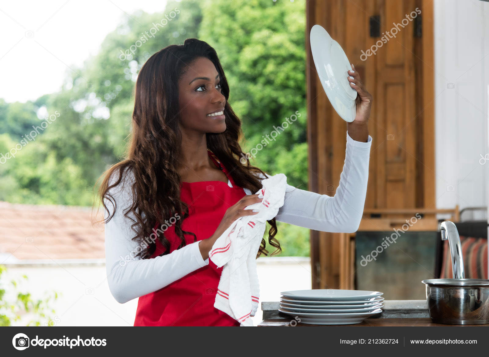 African American Housewife Cleaning Plate Kitchen Home Stock Photo