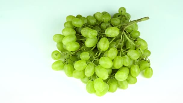 green grape rotating closeup slow motion 4k, isolated on white