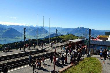 ARTH, SWITZERLAND - SEPTEMBER 29, 2019 : People arrived to end station of Vitznau and Rigi Kulm cogwheel railway at top of Mount Rigi