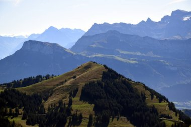Panoramic landscape view of meadows and mountain ranges with snowy mountain peaks from top of Rigi Kulm, Mount Rigi in Switzerland