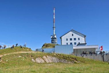 ARTH, SWITZERLAND - SEPTEMBER 29, 2019 : tourists walking near Radio tower and hotel at top of Mount Rigi