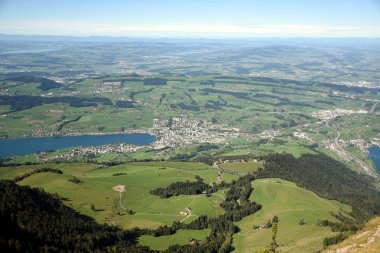 Panoramic landscape view of meadows and Lake Lucerne with Lake Zug from top of Rigi Kulm, Mount Rigi in Switzerland