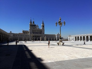 Madrid, Spain 07.11.2017: Huge closed square at the and beautiful buildings of the Royal Palace of Madrid