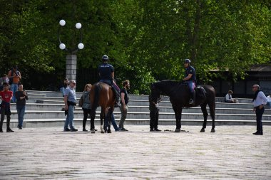 Milan, Italy, 20.07.2019: Italian mounted police are patrolling at Piazza Sempione (Simplon Square) in front of Porta Sempione, Sempione Gate, city gate of Milan, called Arco della Pace, Arch of Peace