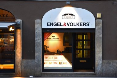 Milan, Italy, 08.04.2019: Entrance, front side of Italian franchised office of Engel and Vlkers German company in the historical center, they provide services related to real estate transactions stock vector