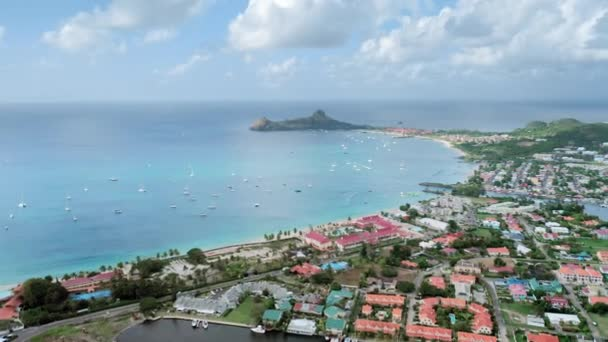 Aerial view of the city landscape and the beautiful port with yachts, surrounded by the sea (Rodney Bay, Saint Lucia)