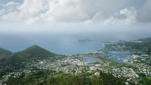 Amazing aerial view of the city, mountains and bay with yachts from a drone (Rodney Bay, Saint Lucia)