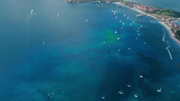 Drone footage of drifting yachts in the blue sea and houses on the mountainous coast (Rodney Bay, Saint Lucia)
