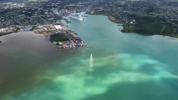 Drone shot of the city on the island with boat and huge liner in the harbor Saint Johns, Antigua and Barbuda