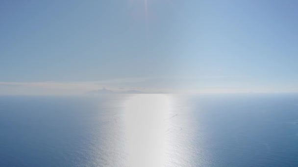 Aerial panoramic shot of azure sea. On the horizon is a mountain shadow Antigua and Barbuda