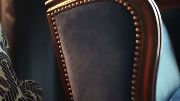 Luxury blue velvet armchair details inside beautiful house interior 4K