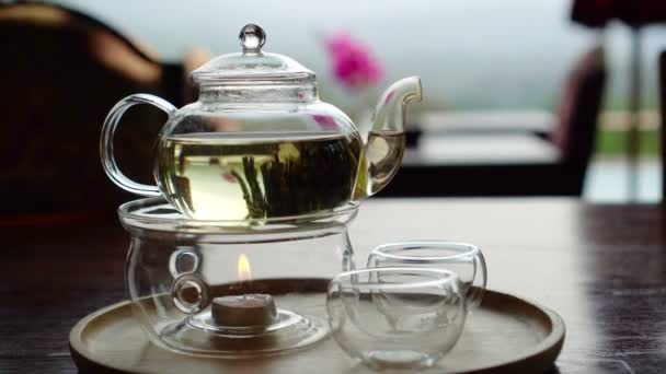 Beautiful flower tea serve in glass pot and cup video