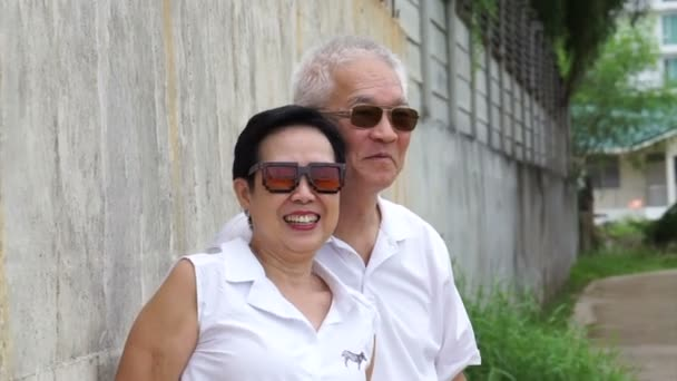 Asian Senior Couple Relax Vacation Around Countryside