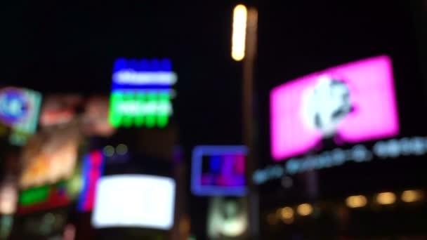 Shibuya crossing people walking blur shot at Tokyo Japan