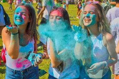 Thessaloniki, Greece - September 2, 2018: Crowds of unidentified people throw colour powder during the