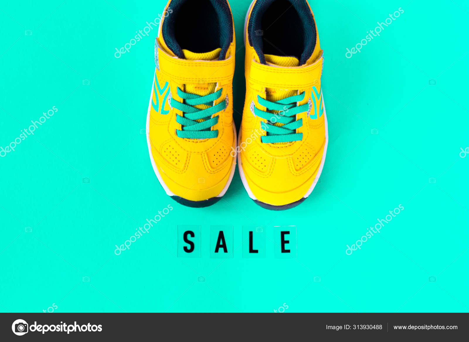 Pair of yellow shoes on blue background