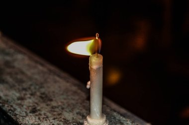 A candle on indian festival diwali deepawali with fire isolated