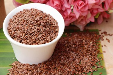 Flax seeds for health on wood background