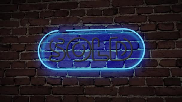 sold neon sign lighting on brick wall background
