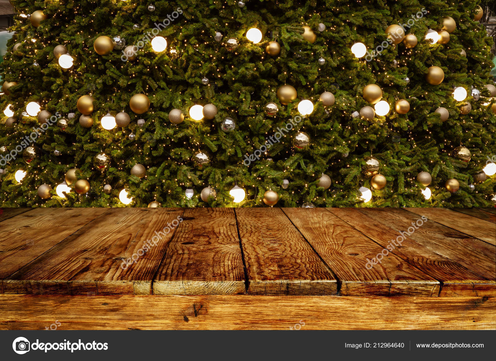 christmas and new year background with empty wooden deck table over blurred christmas tree at night empty display for product montage rustic scene