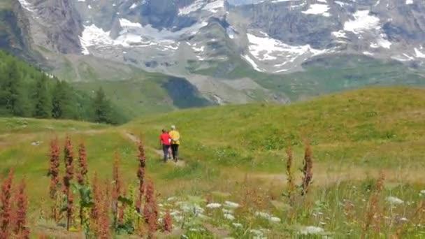 Family women walking hiking Matterhorn Matterhorn view French Swiss Alps Zermatt clouds and blue sky