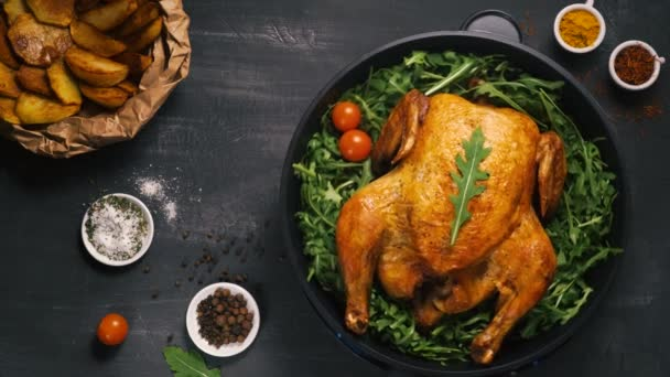 fried chicken or turkey cut by the hands of a person with green herbs in an iron dish
