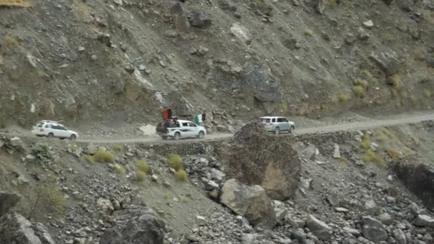 motorcade of cars with the flag of afghanistan drive along the afghan border