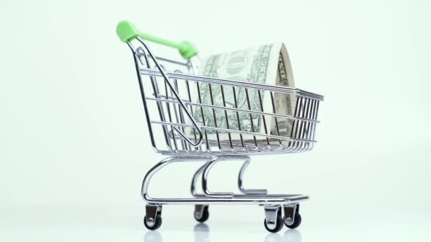 money one dollar in supermarket trolley shopping payment concept