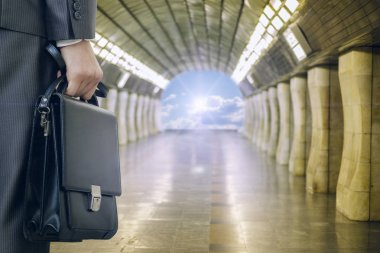 Businessman sees the light at the end of the tunnel. Concept the way to success.