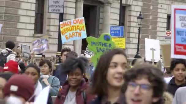 London, UK - October 12th, 2019 : Climate Change Protesters Marching Past, Young people protesting climate change inaction in London, UK.