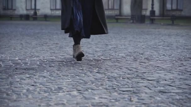 Close-up view of a woman in shoes walking outdoors