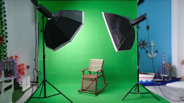Photo studio with chairs and modern equipment