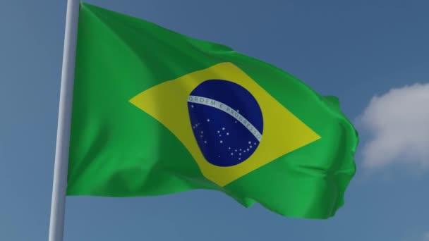 Brazílie Národní vlajka vlaje ve větru s modrou oblohou pozadí