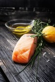 Fish  for healthy seasonal cooking ,black wooden background.