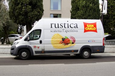 Sirmione , Italy - April 24, 2019: San Carlo Rustica delivery van by the side of the road.